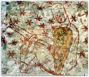 UNn cavalier au combat ,une croix peinte sur son casque