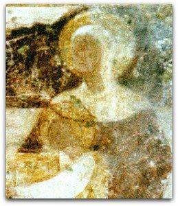 Visages et nimbes parfaitement ronds de la Vierge et de l'enfant