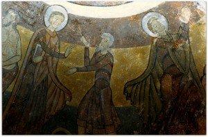 St Gilles guérit un homme puis prie agenouillé devant la mer représentée par des volutes rose orangées