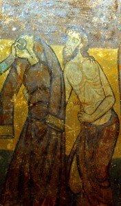 Un pauvre ,torse nu reçoit un vétement de St Gilles (Crypte de St Aignan sur Cher)