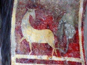 Cabridé sur fond rouge à St Aventain prés de Luchon(Fin du XII iéme siécle)