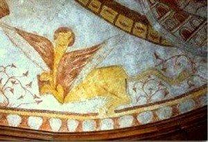 Le lion de St Marc dont la téte évoque un ours et doté d'une trés longue queue,en bas ,à gauche