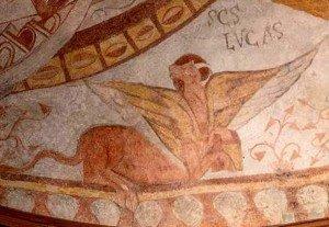 Le taureau de St Luc ,en bas ,à droite,dont la patte arriére déborde des limites de la bordure