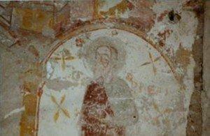 Détail de St André se détachant d'un fond blanc décoré d'étoiles à 4 branches et de fleurettes