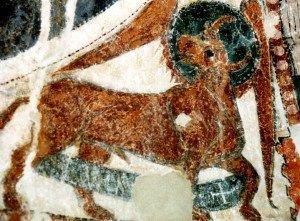 Le taureau de St Luc,un phylactére orné d'une croix pattée entre les les pattes